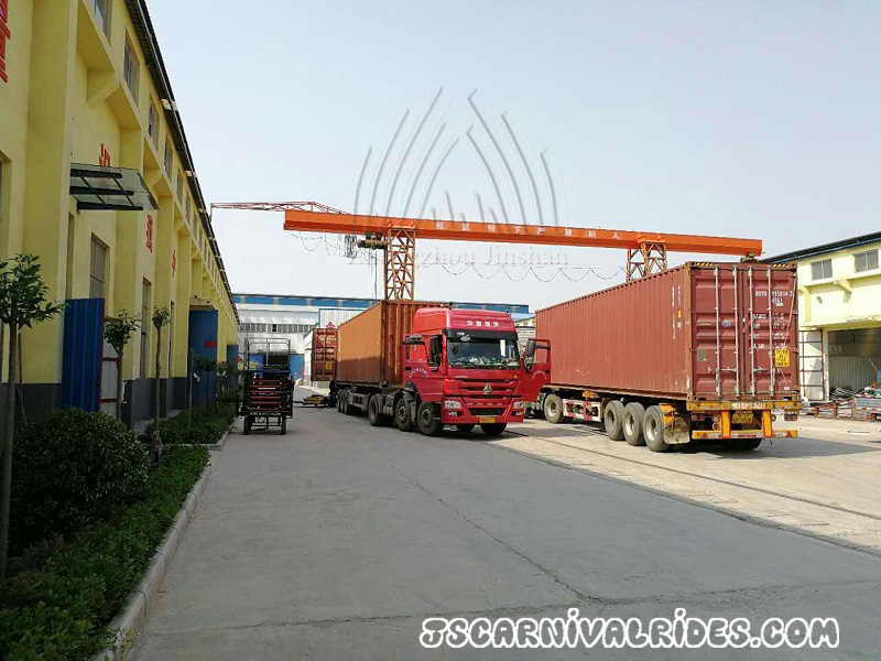 two container trucks shipping carnival rides
